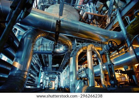 Equipment, cables and piping as found inside of a industrial power plant #296266238