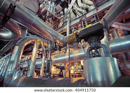 Equipment, cables and piping as found inside of a industrial power plant #404911750