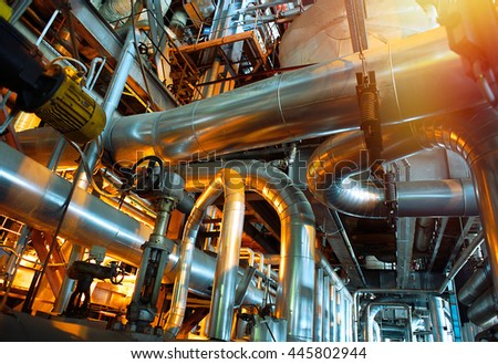 Equipment, cables and piping as found inside of a industrial power plant #445802944