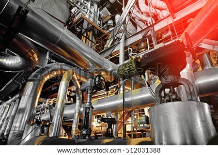 Equipment, cables and piping as found inside of a industrial power plant #512031388