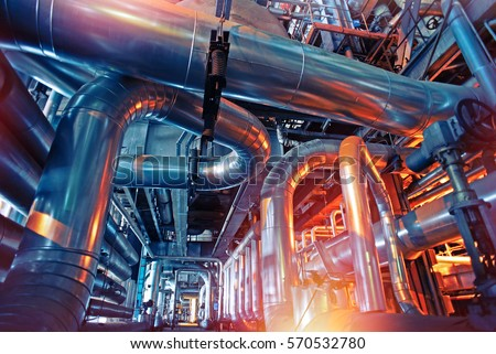 Equipment, cables and piping as found inside of a industrial power plant #570532780