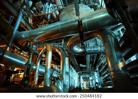 Equipment, cables and piping as found inside of a modern industrial power plant #250484182