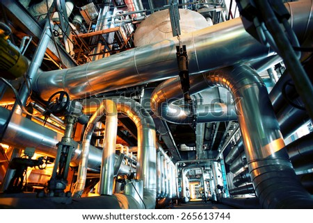 Equipment, cables and piping as found inside of a modern industrial power plant #265613744