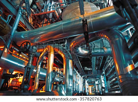 Equipment, cables and piping as found inside of a modern industrial power plant              #357820763