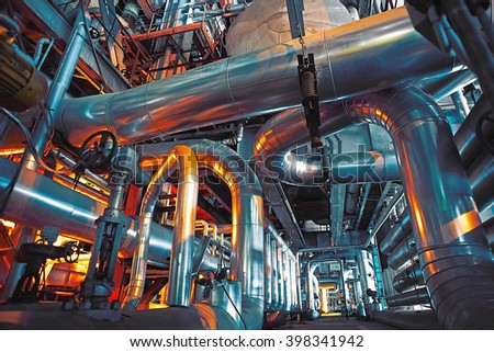 Equipment, cables and piping as found inside of a modern industrial power plant              #398341942