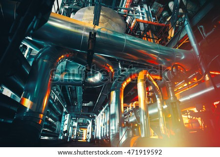 Equipment, cables and piping as found inside of a modern industrial power plant              #471919592