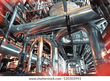 Equipment, cables and piping as found inside of a modern industrial power plant              #520303993