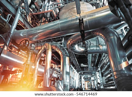 Equipment, cables and piping as found inside of a modern industrial power plant              #546714469