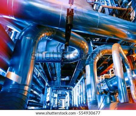 Equipment, cables and piping as found inside of a modern industrial power plant #554930677