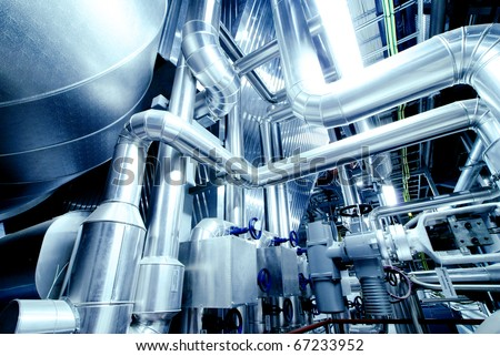 Equipment, cables and piping as found inside of a modern industrial power plant #67233952
