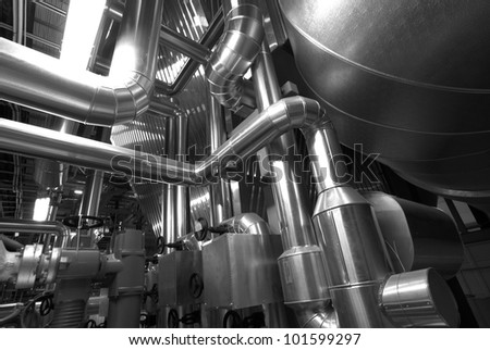 Equipment, cables and piping as found inside of  industrial power plant, b&w