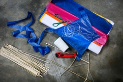 Equipment for making puffer kite such as bamboo frame, rope,colored cellophane, glue,scissors,knife which traditional popular sport for thai people.