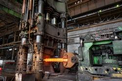 Equipment for pressing hot metal