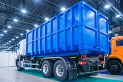 Equipment for public utilities. Truck for the removal of large-sized garbage. Municipal economy. The trash bin is mounted on the truck. Removal of construction debris.