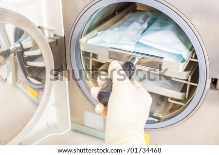 Equipment for sterile cleaning of working medical instruments. The process is carried out by a nurse in a sterile outfit #701734468