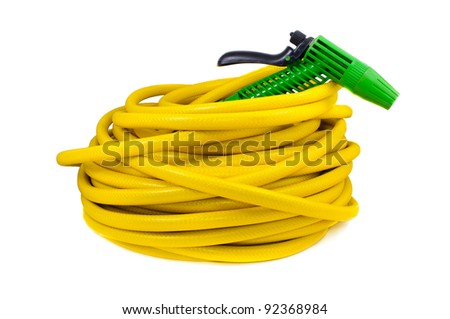 Equipment for watering garden. Hose and spray gun isolated on white background