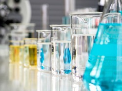 Equipment in science room, test tubes made of glass containing liquid of various colors for chemistry. In process of developing a vaccine for the prevention and treatment of COVID19. Corona virus.