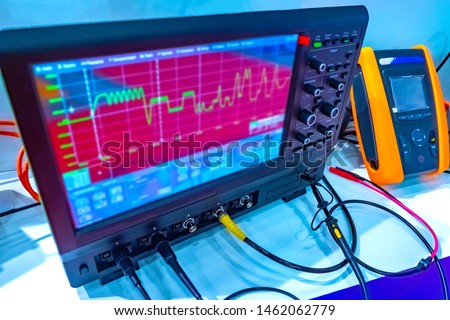 Equipment in the laboratory. Control and measuring devices are connected by wires. Graph on the device screen. Scientific research. scientific research devices.