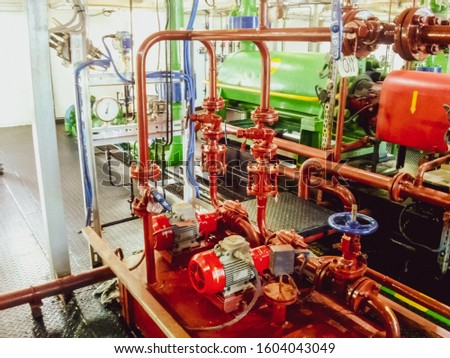 Equipment inside the pumping station for pumping fluid. The oil industry. Pumps and latches. Valves and pipelines