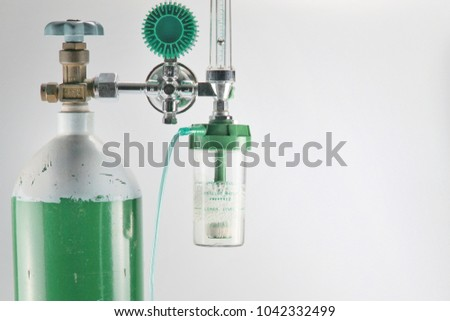 Equipment medical Oxygen tank and Cylinder Regulator gauge.Control pressure oxygen gas for care a patient respiratory disease and emergency CPR at Hospital, Close up focus on white background. #1042332499