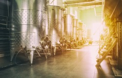 Equipment of contemporary winemaker factory. Wine Cellar And Production, Barrels For Wine storage Modern Development Technology Concept. Inside modern wine factory. Soft focus