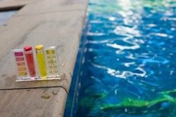 Equipment PH Test Kit on swimming pool chlorine and fresh river water inspector. Procedure to check day week level of safety in pool water to make sure water is clean and can swim