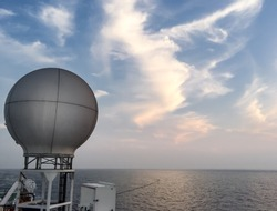 equipments and navigation system on backdesk in seismic vessel ship during sunset in Andaman Sea for oil and gas survey with sky background