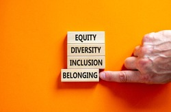 Equity, diversity, inclusion and belonging symbol. Wooden blocks with words equity, diversity, inclusion, belonging on beautiful orangebackground. Diversity, equity, inclusion and belonging concept.