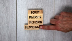 Equity, diversity, inclusion and belonging symbol. Wooden blocks with words 'equity, diversity, inclusion, belonging' on beautiful grey background. Diversity, equity, inclusion and belonging concept.