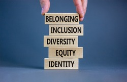 Equity, identity, diversity, inclusion, belonging symbol. Wooden blocks with words identity, equity, diversity, inclusion, belonging on beautiful grey background. Inclusion, belonging concept.