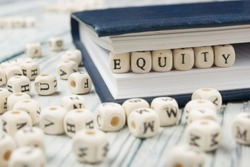 EQUITY word written on wood block. Wooden Abc