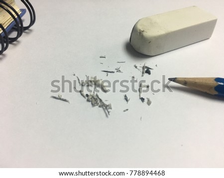 Eraser used And the pencil used. The background is white paper. #778894468