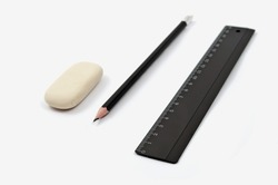 erasers, pencil, ruler on a white background