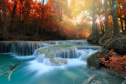 Erawan Waterfall, beautiful waterfall with sunlight rays in deep forest, Erawan National Park in Kanchanaburi, Thailand