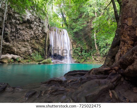 Erawan Waterfall, Kanchanaburi, Thailand. Abundant nature Full of trees And the water is very clear blue water. #725022475