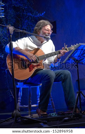 ERBUSCO,ITALY - AUGUST 30:  exhibition live of  guitar player Giorgio Cordini and the player of wind instruments Mario Arcari  at event \