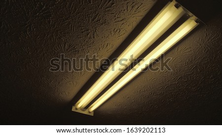 Erie fluorescent light in a dark room