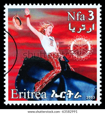ERITREA - CIRCA 2003: A postage stamp printed in Eritrea showing Madonna Louise Ciccone, circa 2003
