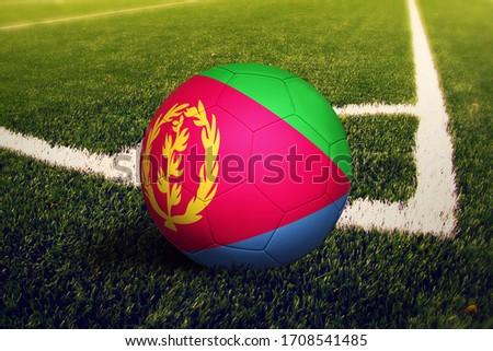 Eritrea flag on ball at corner kick position, soccer field background. National football theme on green grass. ストックフォト ©