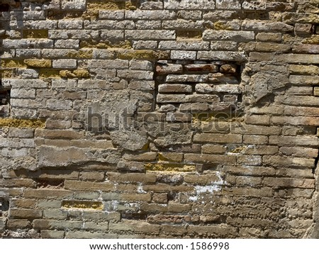 Eroded brick wall