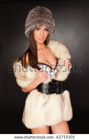 Erotic look with fur, studio isolated shot