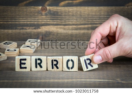 error. Wooden letters on the office desk, informative and communication background