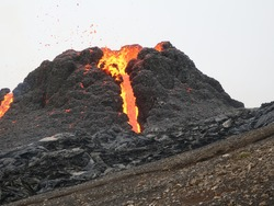 Erupted little volcano in Iceland. March 2021. View of erupting mountain.