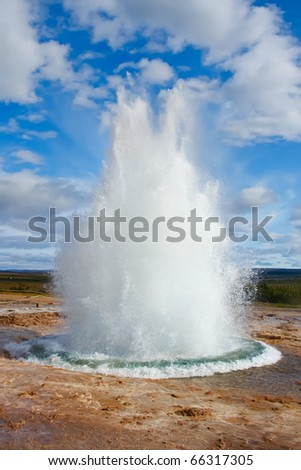Erupting one of the most beautiful geysers in the world
