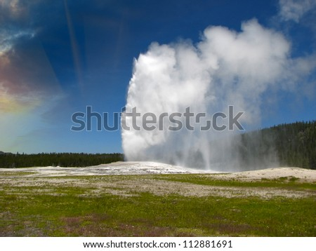 Eruption of Old Faithful Geyser at Yellowstone National Park - USA