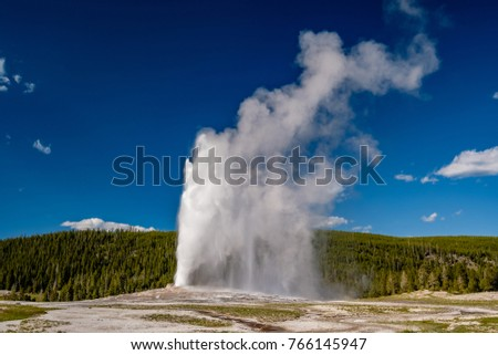 Eruption of Old Faithful geyser in Yellowstone National Park, Wyoming, USA