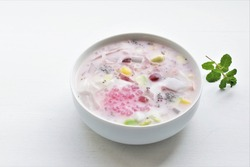 Es Campur Hongkong or Ximilu, made of jelly, tapioca pearls, ice, young coconut, sugar syrup, mixed fruits and coocnut milk or milk.