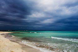 Es Trenc beach under dramatic gloomy sky.  Mallorca island, Spain Mediterranean Sea, Balearic Islands.