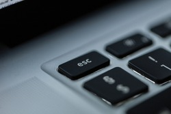 esc button, close-up. Laptop keyboard and exit from the project, concept