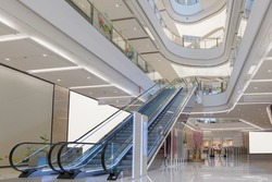 escalator and modern shopping mall interior